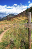 Old sign near hiking trail. Old wooden sign and post near a mountain hiking trail in Idaho royalty free stock photography