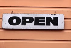 Old sign open. On brown wooden wall Royalty Free Stock Photo