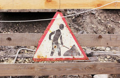 old sign repair work hanging on a wooden fence while eliminating accidents water pipes. stock photos
