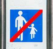 Old sign with a simple symbol forbidding children. Paris Stock Photos