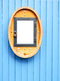 Old sign. A sign in a wooden frame Royalty Free Stock Image