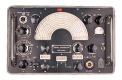 Old signal generator. Vintage radio frequency signal generator for radio and tv repair on a white background Stock Image
