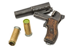 Old  signal pistol, flare gun and cartridges, isolated on white Royalty Free Stock Photo