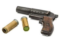 Old  signal pistol, flare gun and cartridges, isolated on white Stock Photo