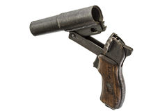 Old  signal pistol, flare gun and cartridges, isolated on white Stock Photography