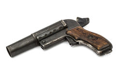Old signal pistol, flare gun with the hammer cocked, isolated. On white background Royalty Free Stock Photography