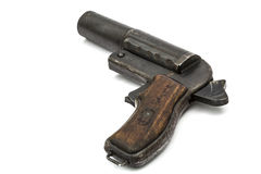 Old signal pistol, flare gun with the hammer cocked, isolated. On white background Stock Photo