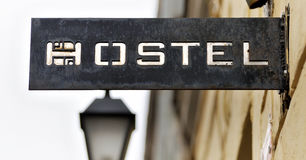 Old signboard hostel. Old metal plate with the inscription Hostel stock image