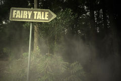 Old signboard with text fairy tale near the sinister forest Stock Photography
