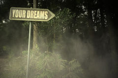 Old signboard with text your dreams near the sinister forest. Vintage old signboard with text your dreams near the sinister forest stock photo