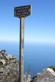 Old signpost on table mountain Stock Photo