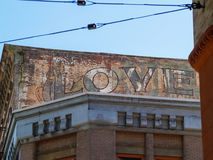 Old signs on brick wall weathering away leaving word love clearl Royalty Free Stock Photos
