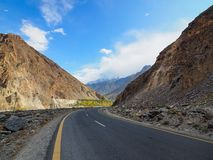 Old Silk Road Along The Karakoram Highway In Pakistan. Locally Known As Kinu-Kutto, The Section Of Visible Road High Up On The Cliff Side Evolved From Being A stock photos