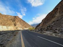 Old Silk Road Along The Karakoram Highway In Pakistan. Locally Known As Kinu-Kutto, The Section Of Visible Road High Up On The Cliff Side Evolved From Being A royalty free stock photos