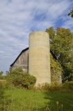 Old silo and abandoned barn Royalty Free Stock Image