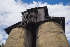Old silo. Decaying old wooden and concrete silo stock images