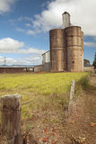 Old silo wheat or corn barn from farmhouse Stock Image