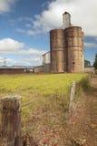 Old silo wheat or corn barn from farmhouse Stock Image