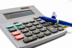 Old silver calculator with book and pen Stock Photos