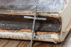 Old silver christian cross on bible Royalty Free Stock Photography
