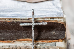 Old silver christian cross on bible Royalty Free Stock Photo