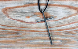 Old silver christian cross on wood Stock Photos