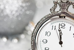 Old silver clock close to midnight and Christmas decorations Royalty Free Stock Photos