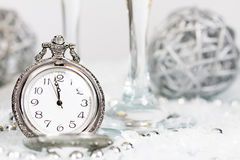 Old silver clock close to midnight and Christmas decorations Stock Images