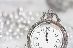 Old silver clock close to midnight and Christmas decorations Royalty Free Stock Image