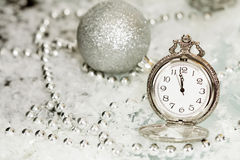 Old silver clock close to midnight and Christmas decorations Stock Photography