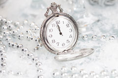 Old silver clock close to midnight and Christmas decorations Royalty Free Stock Photography