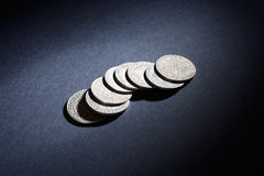 Old silver coins on a black background Stock Images