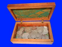 Old silver coins in a box on a blue background Stock Photography