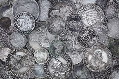 Old Silver Coins. Closeup view of medieval European silver coins. Suitable for an abstract background royalty free stock photos