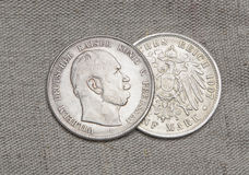 Old silver coins of German reich. Over sack Royalty Free Stock Images