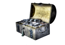 Old silver coins. An old trunk with a small treasure trove of old silver coins in a fantasy atmosphere Stock Photography
