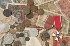 Old silver and copper coins with banknotes and medals background Royalty Free Stock Photo