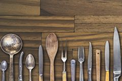 Old vintage cutlery on wooden background. Old silver cutlery on wooden floor. Vintage silver cutlery Royalty Free Stock Image