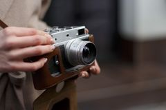 Film camera in the hands of a girl stock photos