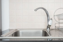 Old silver metal faucet in a kitchen Stock Images