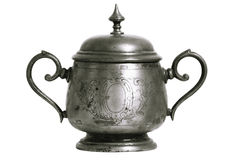 An old silver metal sugar bowl with a lid and ornament. Metal punctles with scratches and patina. Stock Photos