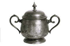 An old silver metal sugar bowl with a lid and ornament. Metal punctles with scratches and patina. Stock Image