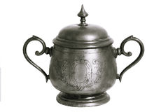 An old silver metal sugar bowl with a lid and ornament. Metal punctles with scratches and patina. Royalty Free Stock Image