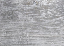 Old silver paint smears close-up on concrete wall Royalty Free Stock Photos