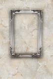 Old silver picture frame on the marble effects background. Old silver picture frame on the beige marble effects background Stock Photo