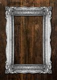 Old Silver Picture Frame on wooden background. Old Silver Picture Frame on wood baclground Royalty Free Stock Image