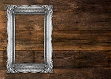Old Silver Picture Frame on wooden background. Old Silver Picture Frame on wood baclground Stock Images