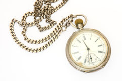Old silver pocket watch. Old silver pocket watch with fob on overwhite background royalty free stock photography