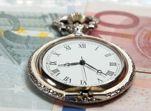 Old silver pocket watch with EURO curerrency Royalty Free Stock Photo