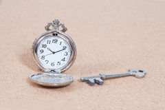 Old silver pocket watch and key Royalty Free Stock Images